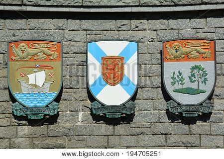 Victoria BC,Canada,July 28th 2014.The coats of arms for the Canadian provinces of New Brunswick,Nova Scotia and Prince Edward Island hang on a wall in Victoria BC.