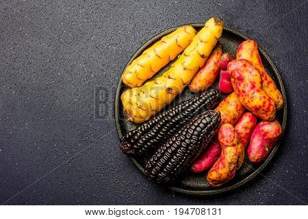 Peruvian raw ingredients for cooking black corn and sweet potatoes