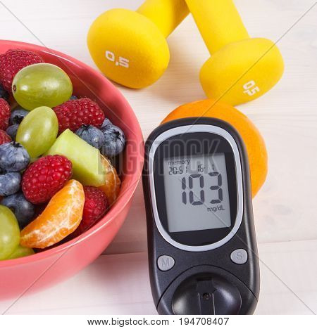 Fruit Salad, Glucose Meter And Dumbbells, Diabetes, Healthy Food And Nutrition Concept