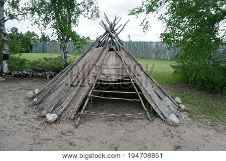 A representation of an Anishnaabek lodge stands in the Colonial Michilimackinac State Park in Mackinaw City, Michigan.
