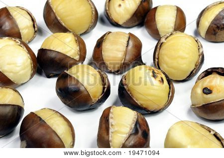 Delicious grilled chestnuts as background