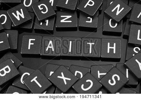 Black letter tiles spelling the word