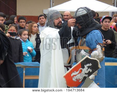 TUCUMÁN, ARGENTINA - JULY 8, 2017 - Medieval Fest for kids. People disguissed with medieval clothes. Fights. Fitting the helmet