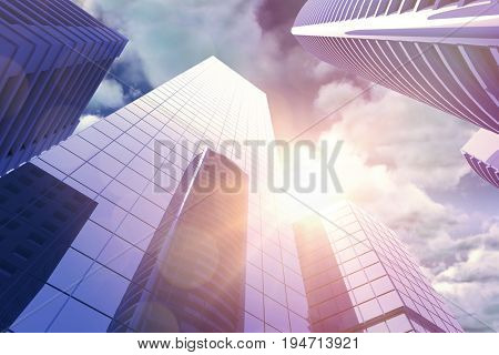 Low angle view of skyscrapers in city against view of overcast against blue sky