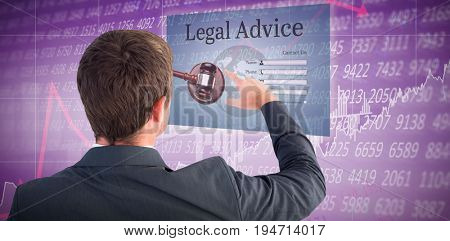 Businessman pointing with his finger against stocks and shares