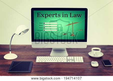 Graphic interface of lawyer contact form  against computer with digital tablet and mobile phone on desk