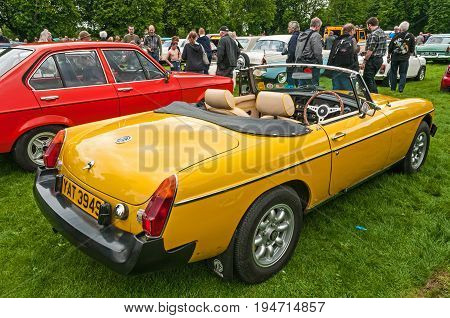 Yellow MGB Roadster,Hull, East Yorkshire, England, 11th June 2017, Classic British MG Sports Car, close up showing side and rear of yellow MGB roadster at East Park Classic Car Run.