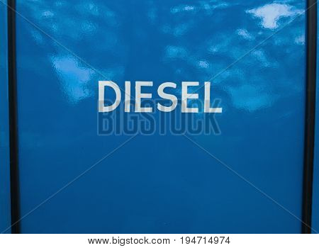 White painted diesel sign on blue background