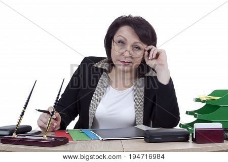 Business woman at the desk on a white background