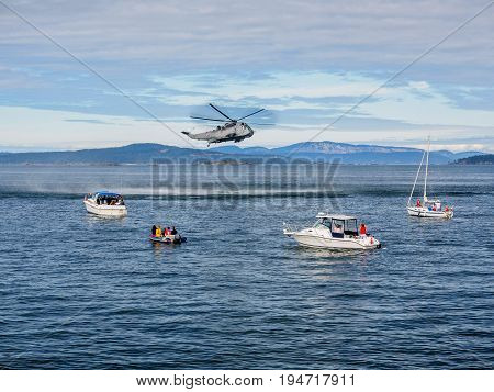 Helicopter crew performing water rescue training exercise