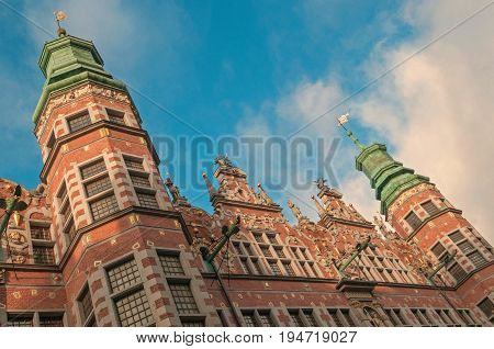 Gdansk, Poland - December 12, 2015: Historical facades of Great Armoury Tenement House in Gdansk, Poland. Sculptural works - Abraham van den Blocke in the beginning of the 17th century