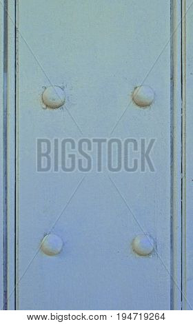 Powder Blue painted wooden background with four domed studs
