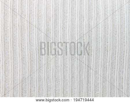 White knitting or knitted fabric texture pattern background. Knitting or knitted. White knitting background. Beautiful knitting texture.
