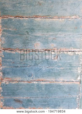 old worn wood boards with chipping and peeling green paint