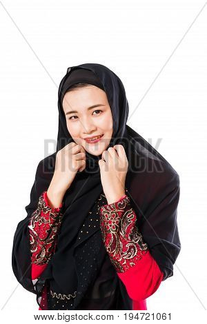 Portrait of beautiful young muslim woman with headscarf on a white background. Fashion concept