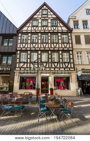 STUTTGART GERMANY - MARCH 18 2016: Fachwerkhaus (Half-timbered) in a historic street Calwer Strasse in the city center. Stuttgart is the capital and largest city of the state of Baden-Wuerttemberg.