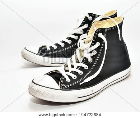 black sneakers isolated on a white background