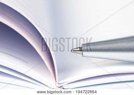 selective focus of the ball pen on opened lined diary book