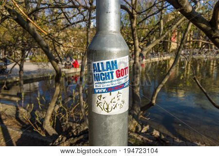 STUTTGART GERMANY - MARCH 18 2016: Provocative sticker on a lamppost. The inscription in German: Allah is not God! Stay Free!