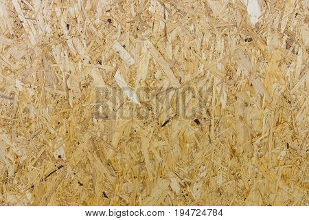 The texture of yellow chipboard with large structure. Background.