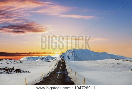 Landscaped the road in winter, road trip on the country road in sunrise