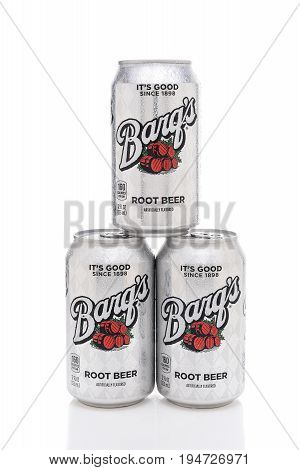 IRVINE CALIFORNIA - JULY 10 2017: Three Barqs Root Beer cans with condensation. Created by Edward Barq and still currently owned by the Barq family but bottled by the Coca-Cola Company.
