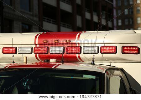 Red white beacons emergency van background detail