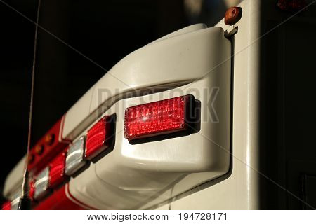 Ambulance car head lights closeup white red
