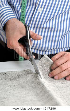 Dressmaker cutting fabric - A series of TAILOR related images.