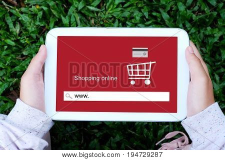 Hand holding tablet with www. on search bar screen background on line shopping business E-commerce technology and digital