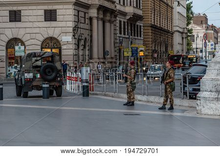 Rome Italy - August 18 2016: Italian soldiers guarding the Piazza Cavour in Rome. Italian army is protecting important places and monuments in Rome as part of an anti-terrorist operation.