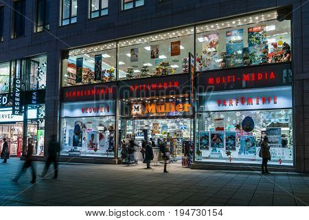 STUTTGART GERMANY- MARCH 16 2016: The historic shopping street in the central part of the city - Koenigstrasse (King Street) and a showcase well-known store Mueller.