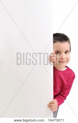 Cute boy holding empty board isolated on white.
