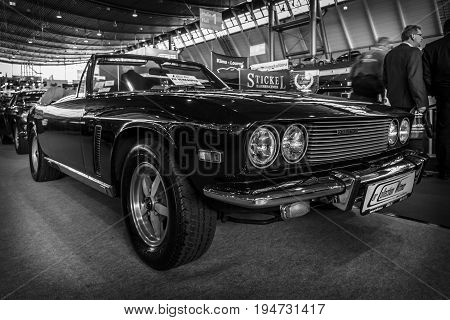 STUTTGART GERMANY - MARCH 17 2016: Grand tourer car Jensen Interceptor MkIII Convertible 1974. Black and white. Europe's greatest classic car exhibition
