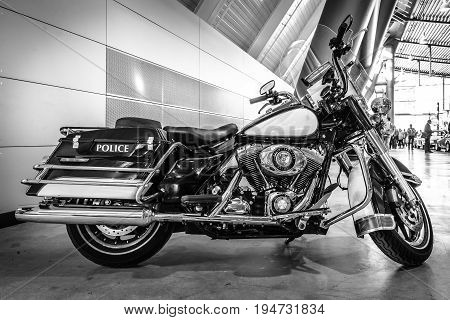 STUTTGART GERMANY - MARCH 17 2016: Motorcycle Harley-Davidson FLHR Police 2008. Black and white. Europe's greatest classic car exhibition