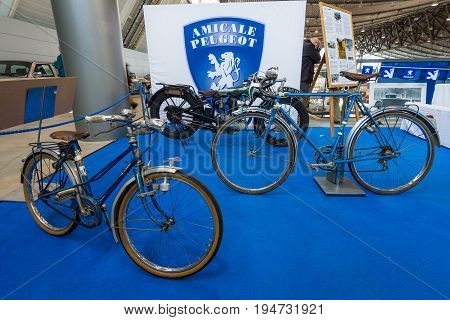 STUTTGART GERMANY - MARCH 17 2016: Motorcycle Peugeot 105 (Type 350A) 1927 and Peugeot bicycles. Europe's greatest classic car exhibition
