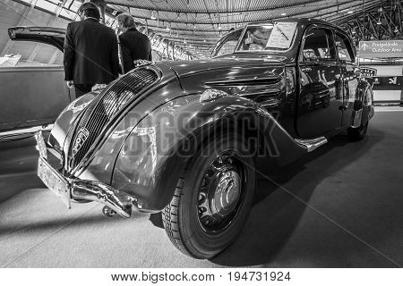 STUTTGART GERMANY - MARCH 17 2016: Large family car Peugeot 402 Legere E 1939. Black and white. Europe's greatest classic car exhibition