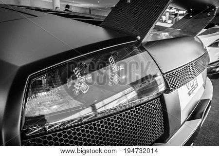 STUTTGART GERMANY - MARCH 17 2016: The rear brake lights of sports car Lamborghini Murcielago PL650R 2007. Black and white. Europe's greatest classic car exhibition