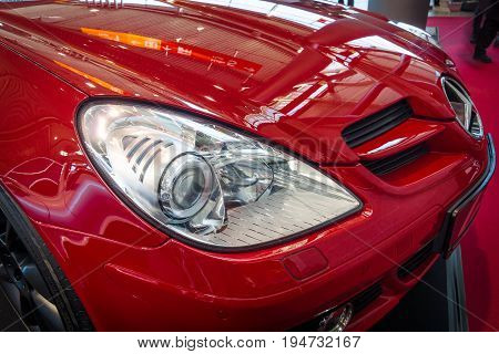 STUTTGART GERMANY - MARCH 17 2016: Headlamp of a sports car Mercedes-Benz SLK 200 Kompressor (R171) 2006. Europe's greatest classic car exhibition