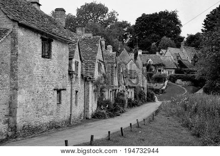 British Traditional stone cottages at Arlington Row in Bibury Cotswolds England