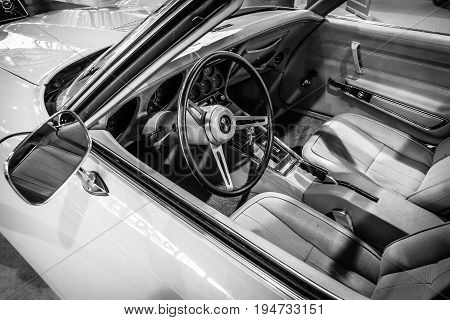 STUTTGART GERMANY - MARCH 17 2016: Cabin of sports car Chevrolet Corvette Stingray Coupe (C3) 1975. Black and white. Europe's greatest classic car exhibition