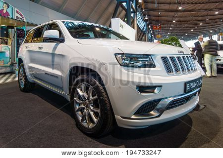STUTTGART GERMANY - MARCH 17 2016: Mid-size luxury crossover SUV Jeep Grand Cherokee 2015. Europe's greatest classic car exhibition