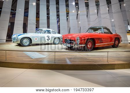 STUTTGART GERMANY - MARCH 17 2016: Racing car Mercedes-Benz 300 SL (W194) and the sports car Mercedes-Benz 300 SL Roadster (W198). Europe's greatest classic car exhibition