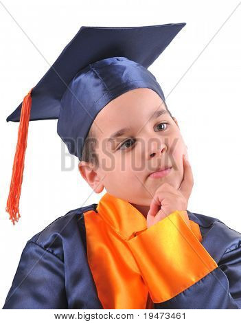 Little boy in cap and gown mimicking