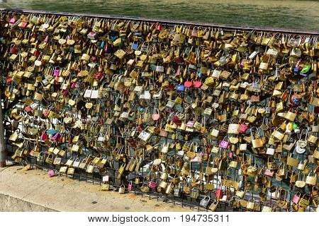Paris, France - May 16, 2017: The Famous Love Padlocks which have been by the Square du Vert Galant over the river Seine.