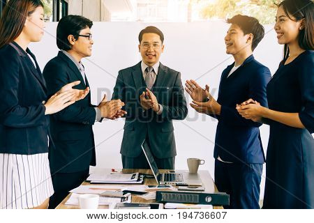 Business people clapping hands during a meeting success and team work concept.