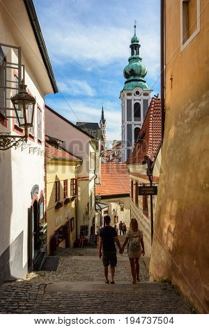 Cesky Krumlov - June 9, 2017: Tourists on a narrow old street in the Czech Krumlov, Czech Republic