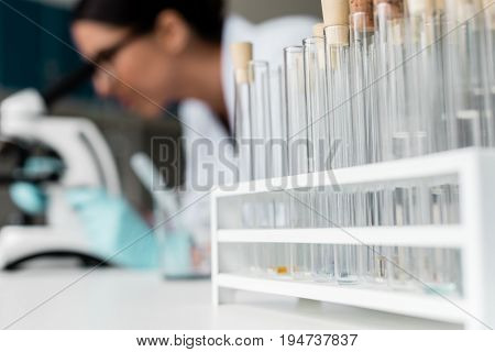 Close-up View Of Test Tubes With Reagents And Samples On Table In Chemical Lab