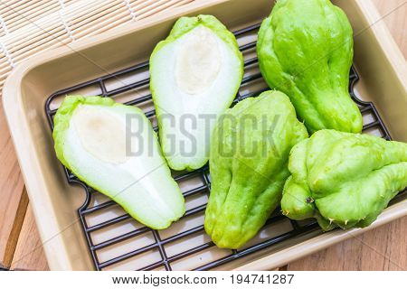 Fresh Chayote fruit on wooden table background