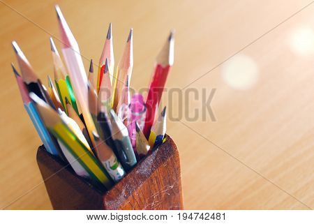 Pencil box , isolated on a wood background